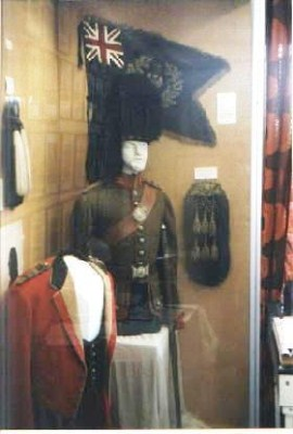 The Uniform of Captain RFB Dickinson and a Pipe Banner of the Queen's Own Cameron Highlanders